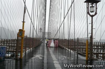 A wedding in the rain on the Brooklyn Bridge