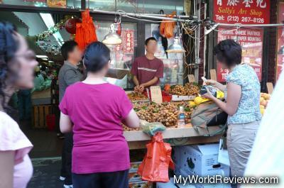 Buying lychee fruit from a street vendor