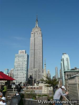 The rooftop patio with a view of the Empire State Building