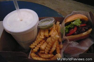 Two burgers, fries, and a milkshake
