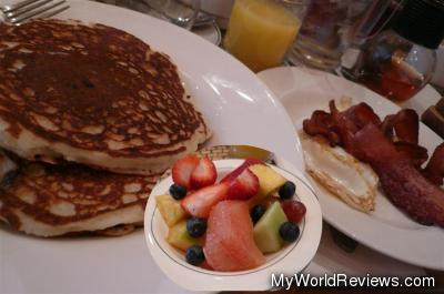 Walnut Banana Blueberry Pancakes with eggs and bacon (and tea, juice, fruit)