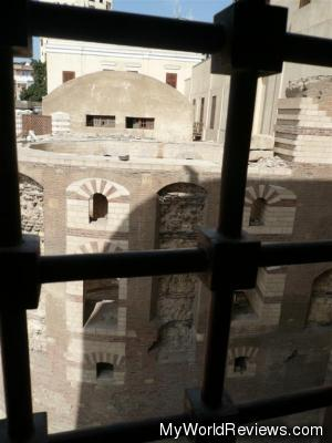 Through the windows in the church you can see the old fortress